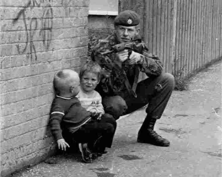 A-british-soldier-on-foot-patrol-in-belfast-ireland-using-two-young-irish-boys-for-cover