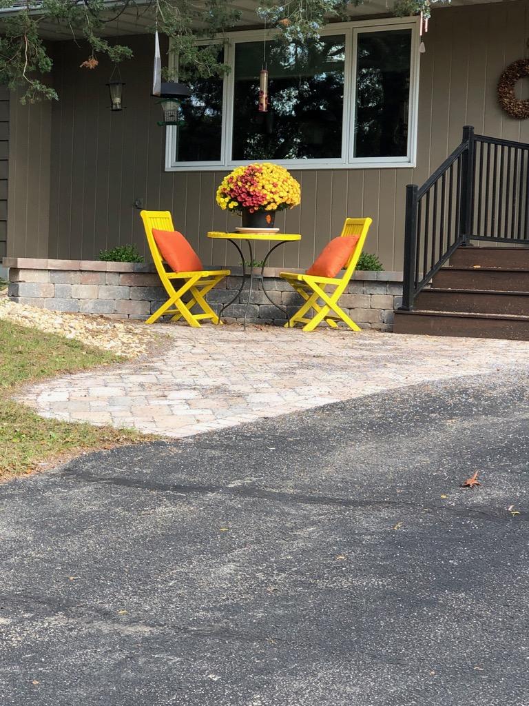 Yellow table  orange cushions